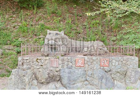 WAKAYAMA JAPAN - JULY 23 2016: Sculpture of a tiger (1959) at the entrance of Wakayama castle Japan. Castle buildings resemble a tiger lying on Mount Torafusu side when seen from the ocean