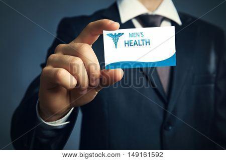 Businessman holding business card close up. Urology concept