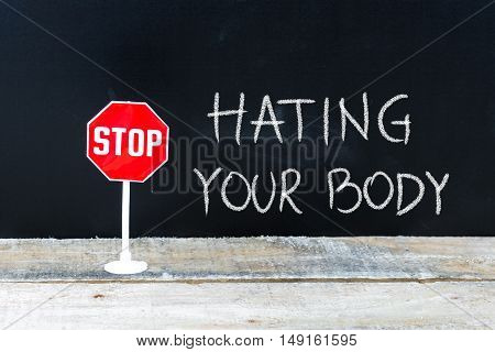 Stop Hating Your Body Message Written On Chalkboard