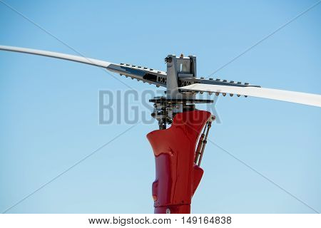 A gyrocopter (autogyro, gyroplane, rotaplane, helicopter) propeller closeup with blue sky on the background.