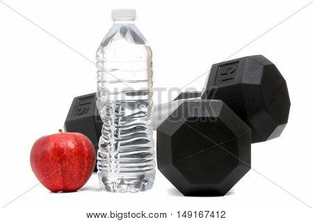 fitness concept weights water and a red apple isolated on white background