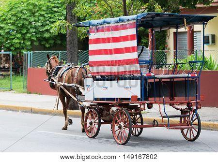 Varadero, Cuba - September 06, 2016:  Horse-drawn carriage in Varadero Cuba