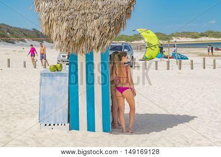 JERICOACOARA, BRAZIL, DECEMBER - 2015 - Attractive young womans with bikinis posing for a photo at Lagoa do Paraiso beach in Jericoacoara Brazil