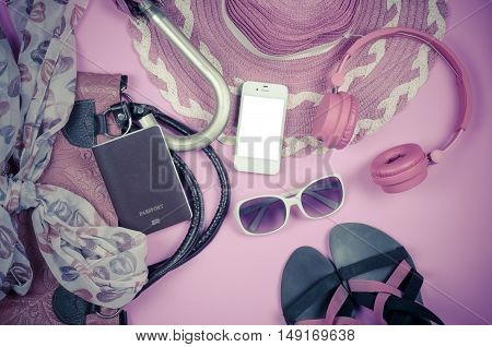 Travel accessories bags scarves umbrellas wallets headphones. Vodafone Passport smart shoes ready for the trip.