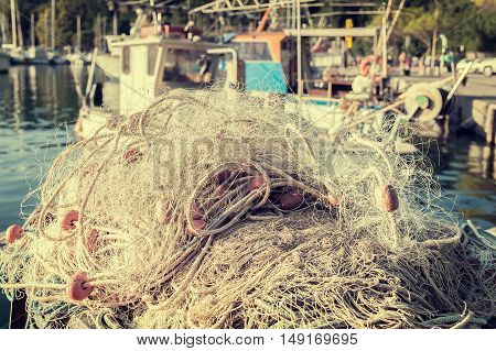 Fishing net drying in the sun. Photo in styles vintage