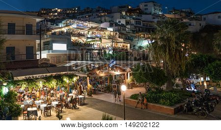 Rethymno, Greece- August, 21 2016. View of Agia Galini village. Once a peaceful fishing village now a popular tourist destination. The local taverns and cafes are crowded with tourists and locals.