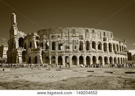 Colosseum surrounded by crouds of people in sunny day Rome Italy