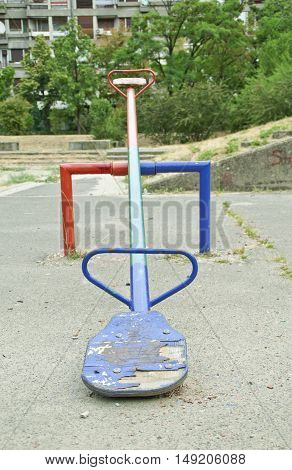 One teeter saturated with color shot in a playground