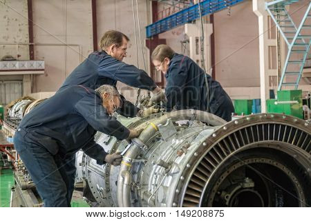 Tyumen, Russia - November 14, 2007: JSC Tyumenskie Motorostroiteli. Plant on production and repair of aviation engines. Workers assemble turbine of aviation engine