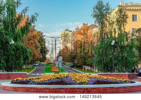 BELGOROD RUSSIA - SEPTEMBER 10 2016: Street fiftieth anniversary of the Belgorod region in the central part of the city. Roadway with pedestrian zones building the mid 50s.