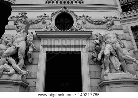 Hofburg in Vienna and greek style statues around the door in b/w