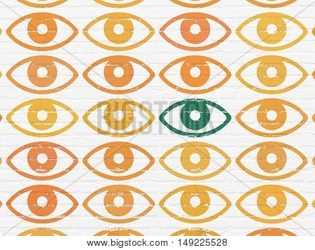 Security concept: rows of Painted orange eye icons around green eye icon on White Brick wall background