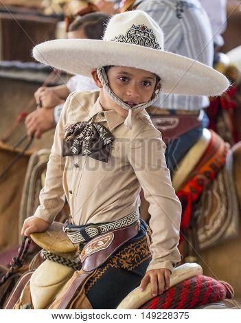 GUADALAJARA MEXICO - SEP 01 : Young charro participates at the 23rd International Mariachi & Charros festival in Guadalajara Mexico on September 01 2016.