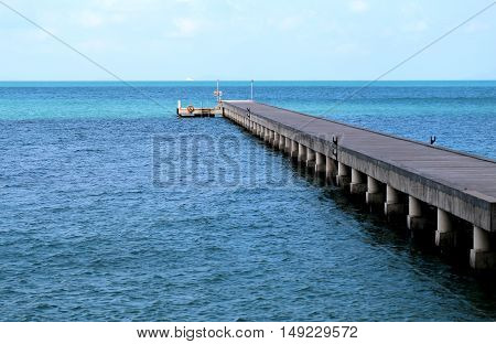 Beautiful pier in a blue sea photographed in close-up