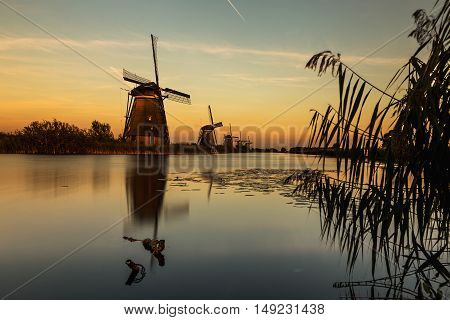 Windmills of Kinderdijk near Rotterdam in Netherlands. Colorful spring scene in the famous Kinderdijk canals with windmills, UNESCO world heritage site