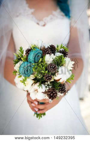 nice turqoise wedding bouquet in bride's hand