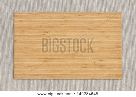 blank block or wooden cutting board for food preparation on tablecloth in the kitchen or top view wood table for work isolated included clipping path for wooden block
