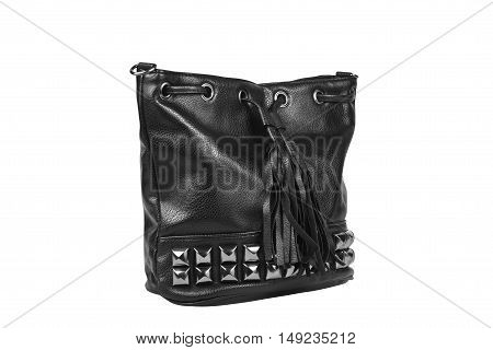 luxury leather black bag on side view with diamond studs and fringe tuft for women on white isolated included clipping path