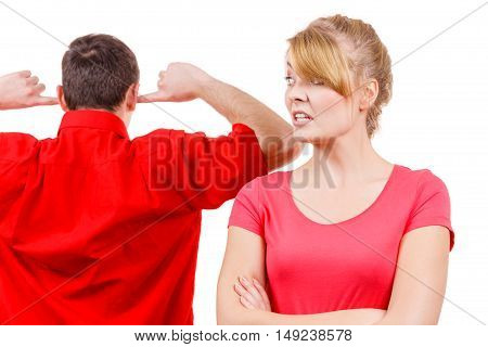 Couple having argument conflict bad relationships. Angry emotional woman talking screaming while man standing with fingers in his ears not listening