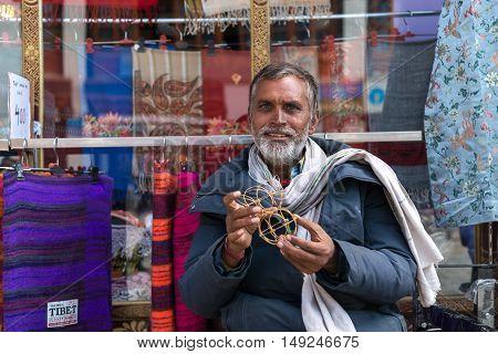 LEH LADAKH, INDIA - JULY 19, 2016 : Unidentified male selling products on street market in Leh city, Ladakh, Inidia on Jul 19, 2016.