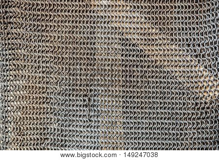 Metallic silver coat of mail full of rings. Textured background