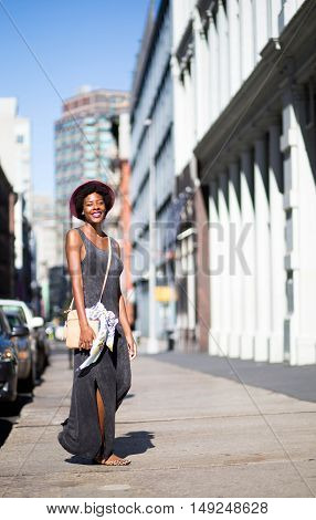 Portrait of young African American girl on city street. Photographed in Soho NYC.