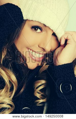 Playful beautiful winter woman wearing hat