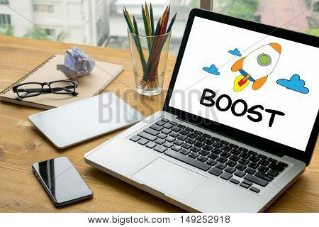Boost Laptop on table. Warm tone business