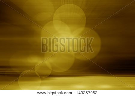 bstract gold background with light effects holiday card.