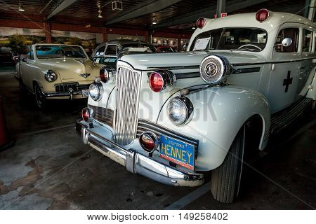 El Segundo, CA, USA - September 26, 2016: White 1942 Packard Ambulance at the Automobile Driving Museum in El Segundo, California, United States. Editorial use only.