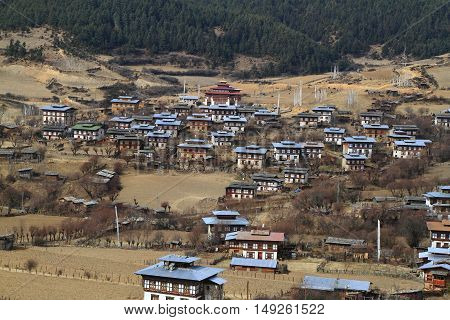 Colorful Dzong In Beautiful Bhutanese Village