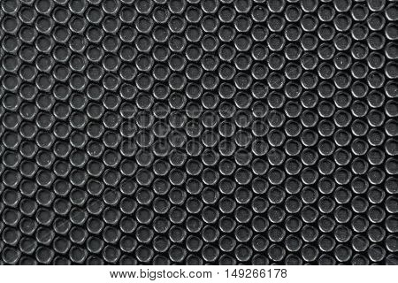 Old Black Metal Background With Holes And Dust.
