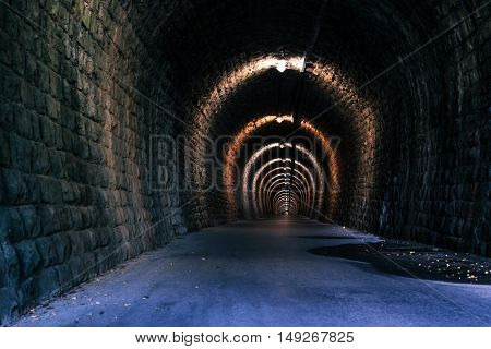 Endless tunnel as abstract background with vanishing point perspective