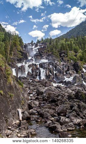 Uchar Waterfall on the Chulcha River near chulyshman river Altai Russia