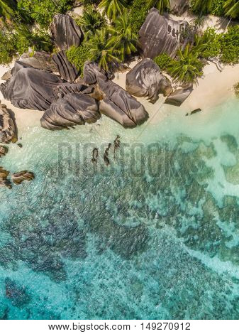 Aerial photo of Seychelles tropical beach Anse Source D Argent at La Digue island