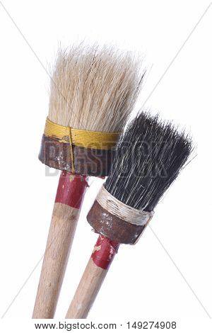 Old unused paint brushes closeup isolated on white background