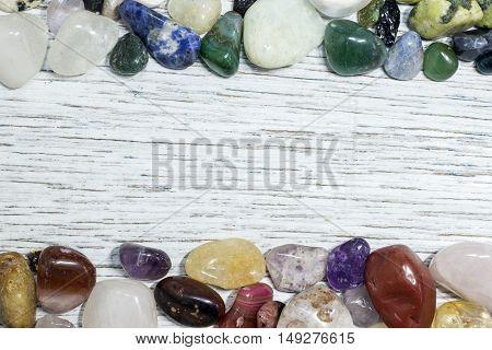 Border frame made of gemstones on antique painted wood board