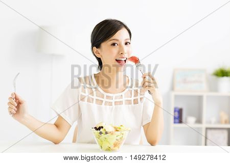 beautiful young asian woman eating healthy food