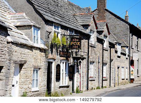 CORFE, UNITED KINGDOM - JULY 19, 2016 - The Fox Inn along a village street Corfe Dorset England UK Western Europe, July 19, 2016.