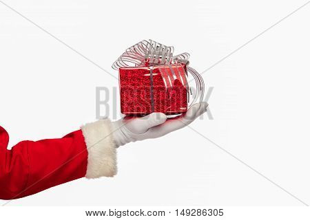 christmas Santa claus giving christmas present box on a white background, isolated.
