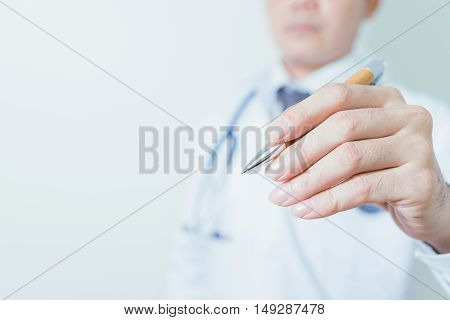 Detail of a doctor holding a pen. Doctor man. Doctor room. Doctor hand. Uniform doctor. Tool doctor. Clinic doctor.
