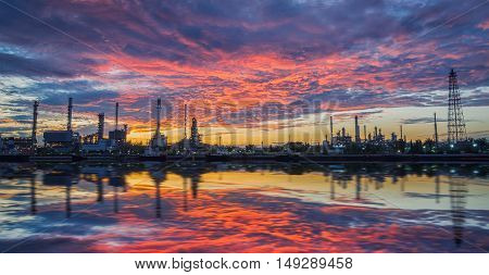 oil refinery industry plant along twilight morning. oil refinery industry reflection. oil refinery on beautiful sky. oil refinery produces gasoline. oil refinery in Bangkok Thailand.