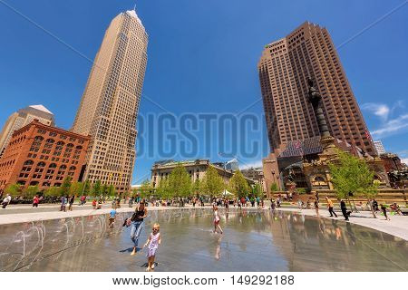People relax in the Cleveland centre Public Square on June 30, 2916, Cleveland, OH