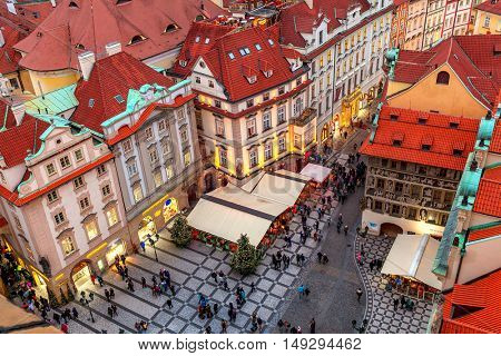 PRAGUE, CZECH REPUBLIC - DECEMBER 10, 2015: View of red roofs, buildings and restaurants at Staromestske Namesti in Old town of Prague, Czech Republic - capital and fifth most visited city in Europe.