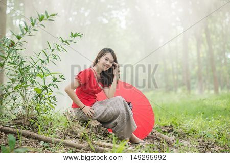 Beautiful Thai Girl In Lanna Traditional Costume With Red Umbrella. Lanna Culture In Northern Thaila