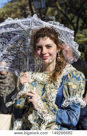 CAGLIARI, ITALY - May 29, 2016: Sunday at La Grande Jatte VIII Ed. At the Public Gardens - Sardinia - portrait of a beautiful girl in Victorian costumes