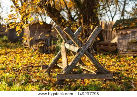 Sawbuck for holding wood so that it may be sawn into pieces wich is in backyard of country house in Belarus