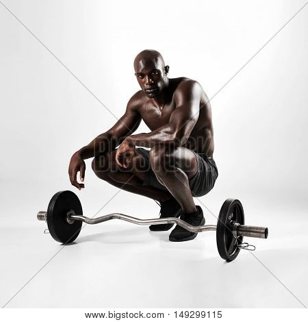 Muscular Man Crouching With Barbell