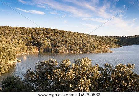 Views of Pedrezuela reservoir Madrid Spain. This artificial lake is surrounded by a thick Mediterranean wood of Holm Oak.