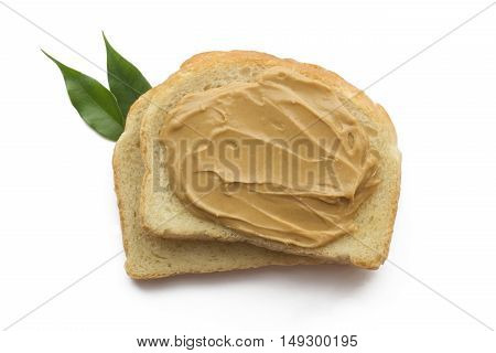 American breakfast.  Peanut butter sandwich on each other isolated with green leaf